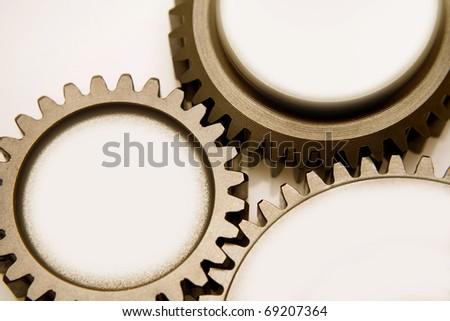 Three metal gears bonding together - stock photo