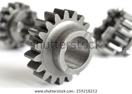 Three metal gears on the white background. - stock photo
