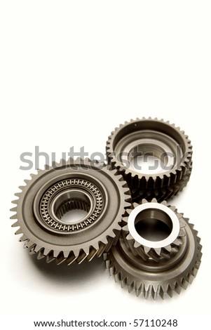 Three metal gears over white - stock photo