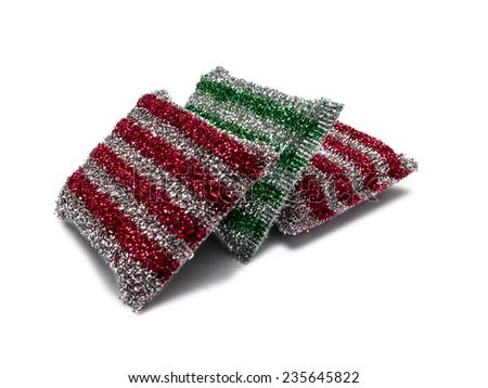 Three metallic colored kitchen sponges isolated on white background - stock photo