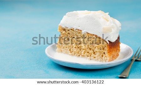 Three milk cake, tres leches cake with coconut. Traditional dessert of Latin America Copy space   - stock photo