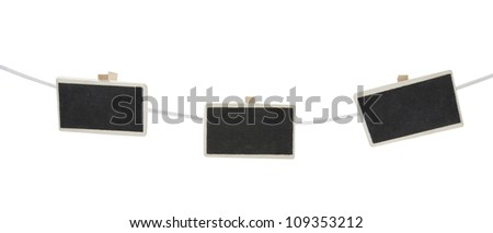 three mini chalkboards on a clothesline  isolated on a white background - stock photo