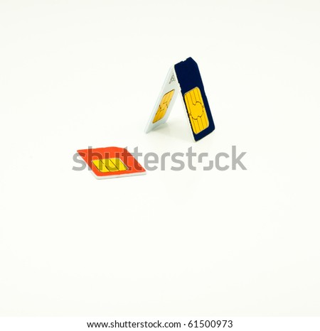 Three mobile phone SIM cards isolated on white - stock photo