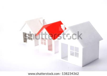 Three models of houses on white background - stock photo