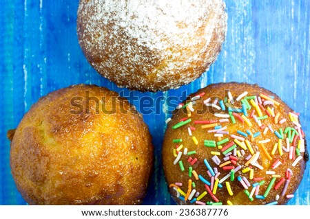 Three muffin. With sweet sprinkles, frosting, icing sugar - stock photo