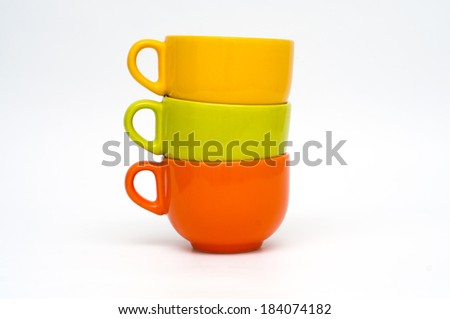 three mugs of different colors - stock photo