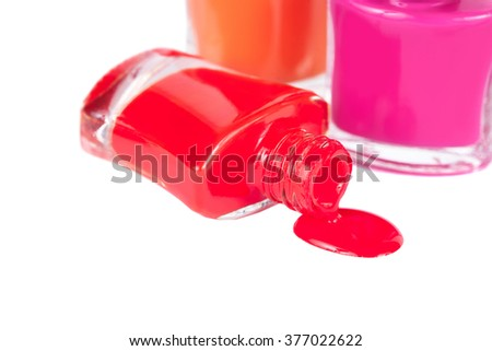 Three multi-colored bright nail polish with reflection - stock photo