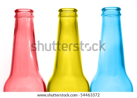 three multicolored bottles isolated on white