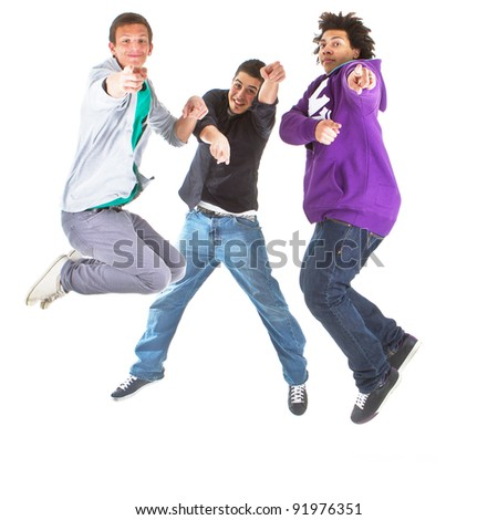 Three multiracial teenagers jumping over joy over white background. - stock photo