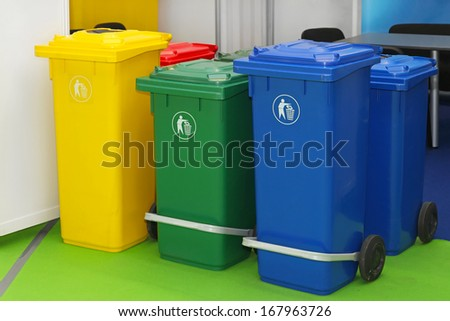 Three new plastic recycling bins for sorting waste - stock photo