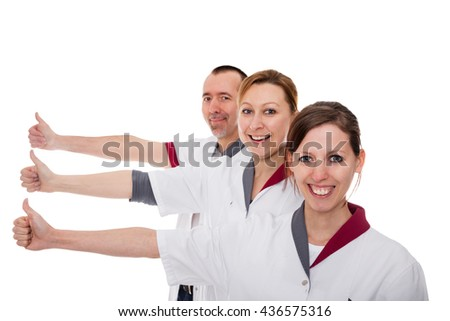 three nurses demonstrate teamwork and success isolated on white