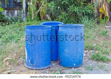 Three old blue trash - stock photo