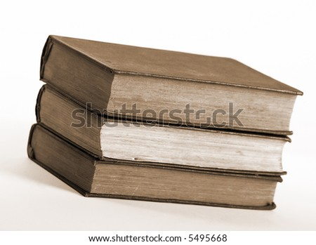 Three old book in pile