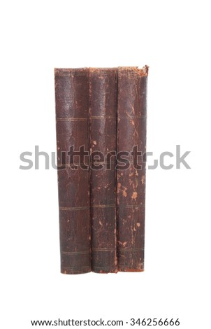 Three old books on white background. Isolated with clipping path