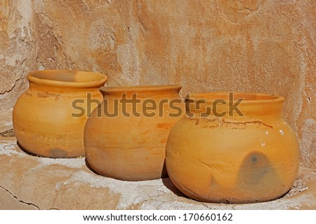 Three old clay pots sit on the shelve in the storage room of the Tumacacori Mission - stock photo