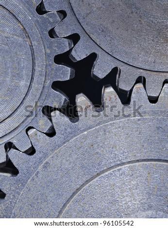 Three old cog gear wheels in closeup. - stock photo