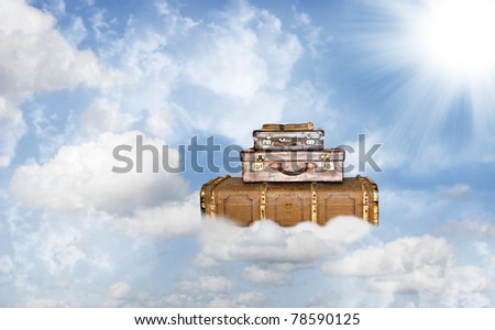 Three old leather suitcases on a heavenly journey - stock photo