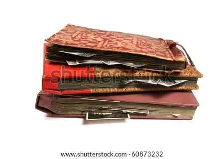 three old photo albums isolated on white background