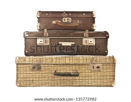Three old suitcase stacked with different size, isolated on white.