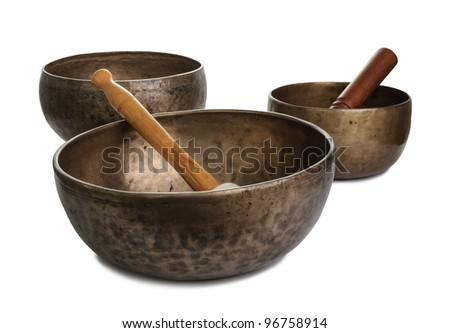 Three old tibetan singing bowls isolated - stock photo
