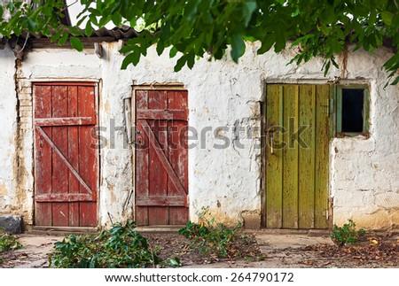 Three old wooden plank vintage doors - stock photo