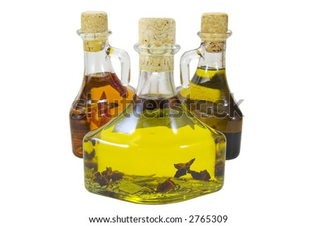 Three olive oil bottles isolated against a white background - stock photo