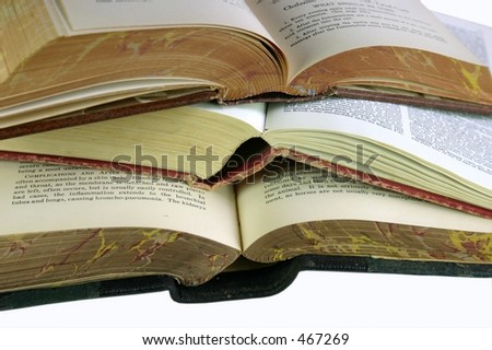 three open old books isolated on white background