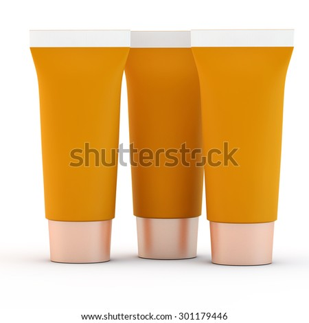 three orange tubes for toothpaste or cream with a blank space for a label - stock photo