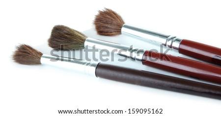 Three paint brushes isolated on white - stock photo