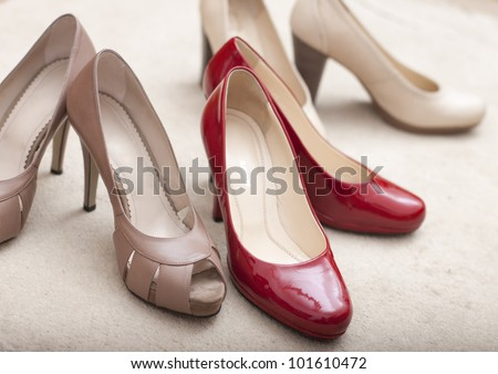 Three pairs of elegant woman's shoes - stock photo