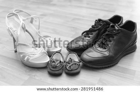 Three pairs of shoes: men, women and children - Family - stock photo