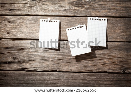three paper on wooden background  - stock photo