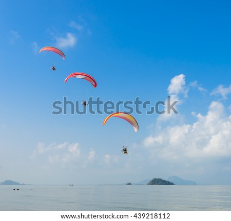 Three Paragliding over Pak Meng Beach in Trang province, Thailand
