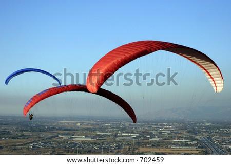 Three parasails soaring over the Salt Lake Valley, Utah - stock photo