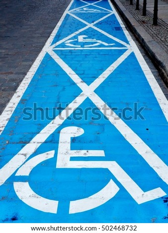 Three parking spaces for disabled people - painted on the street