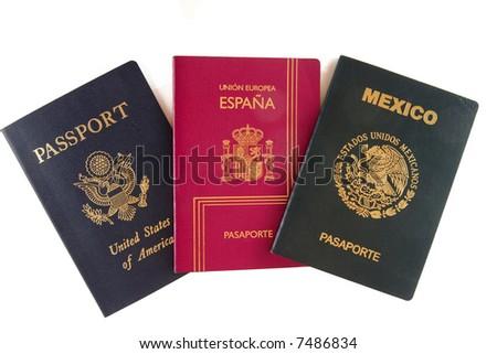 Three passports(american,mexican and spanish) - stock photo