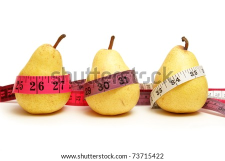 Three pears represent the stages of waistline measurements while losing weight with healthy eating habits. - stock photo