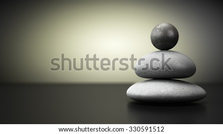 Three pebbles stack over beige and black background, balance stones with room for text on the left. concept image symbol of stability. - stock photo