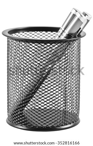 Three pens in a pen holder in form of a black trash can - stock photo