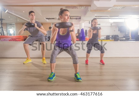 Three people fitness gym squat weights hand