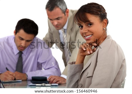 Three people in business meeting - stock photo