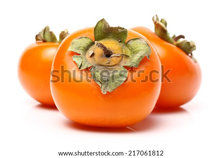 three persimmons on white background  - stock photo
