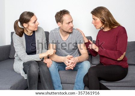 Three persons having an argument