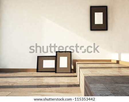 three pictures in the empty room - stock photo