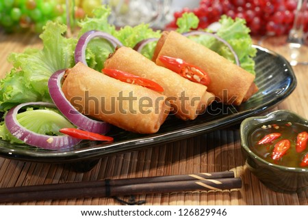 three piece of spring rolls on dish - stock photo