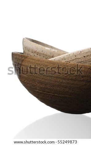 three pieces of handmade pottery on white background - stock photo