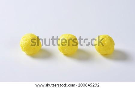 three pieces of round corn puffs - stock photo