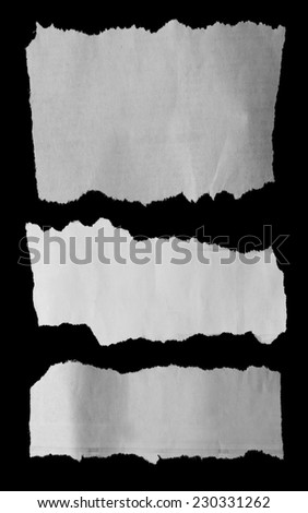 Three pieces of torn paper on black. Copy space