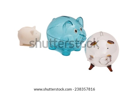 Three Piggy Banks On White Background