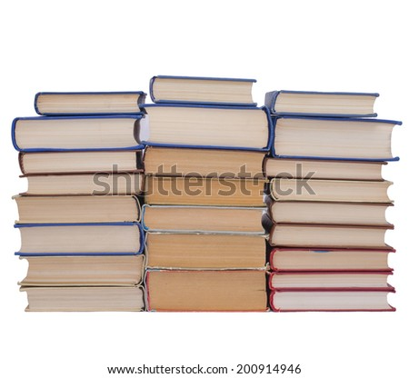Three piles of books isolated on white background